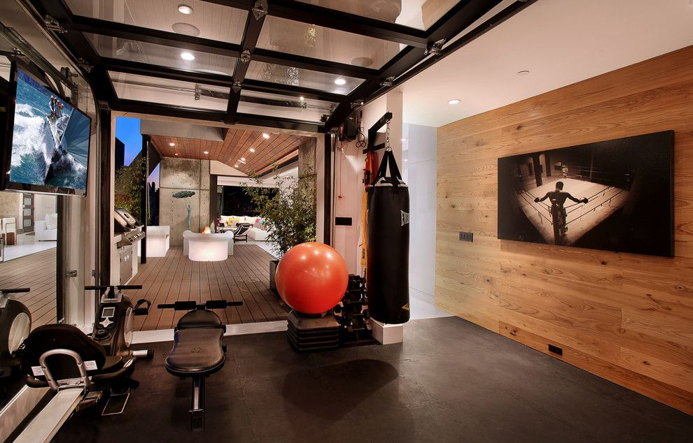 Broken Arrow Theater for a Contemporary Home Gym with a Wood Wall and Acacia by Brandon Architects, Inc.