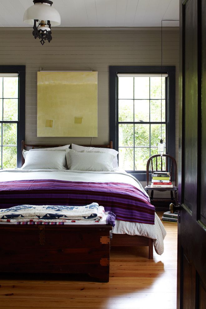 Broken Arrow Theater for a Farmhouse Bedroom with a Purple Blanket and Country Living 2012 by Tim Cuppett Architects