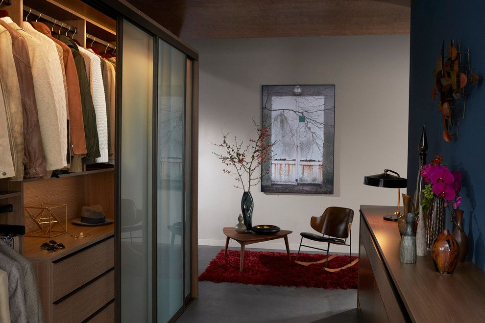 Brosco Doors for a Contemporary Bedroom with a Rocking Chair and Mid Century Master Closet by California Closets Hq