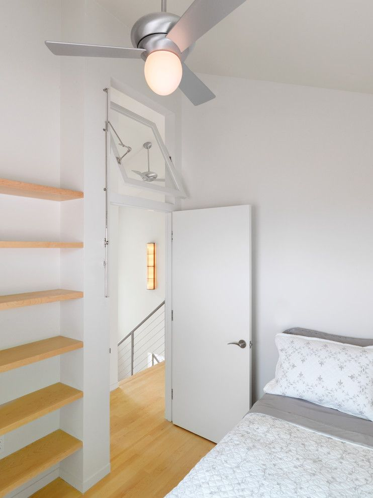 Brosco Doors for a Contemporary Bedroom with a White Walls and Vermont Lake Home by Elizabeth Herrmann Architecture + Design