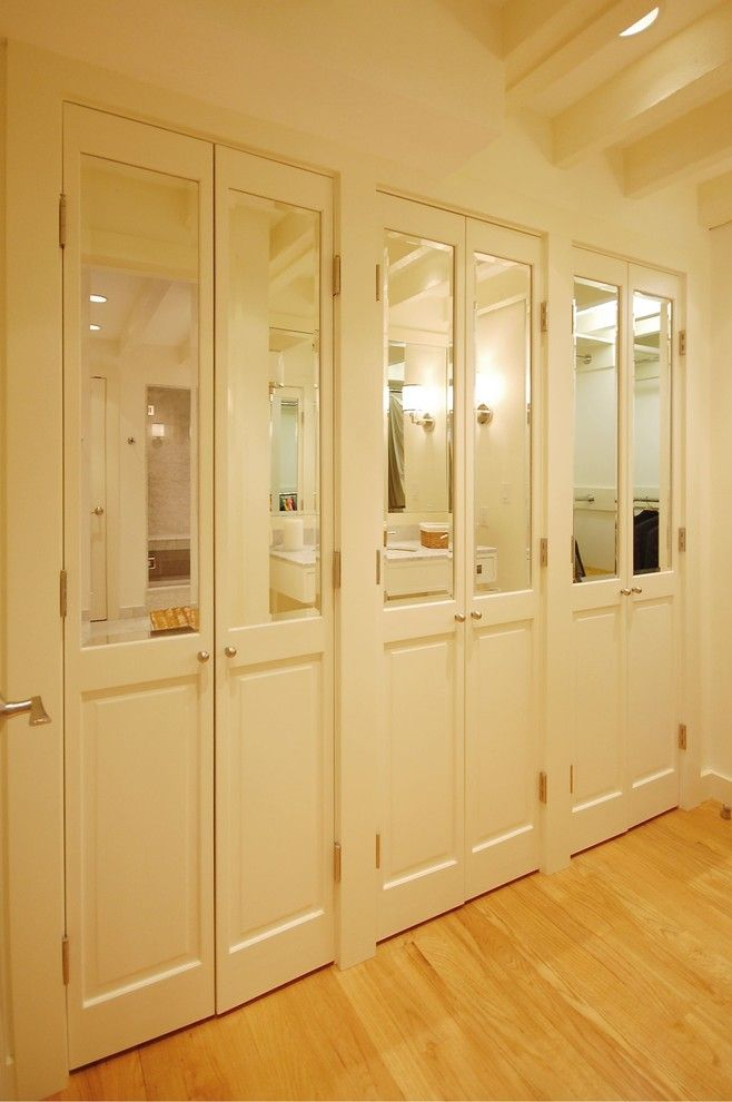 Brosco Doors for a Eclectic Closet with a Wood Floor and Boston Condo by Leslie Saul & Associates