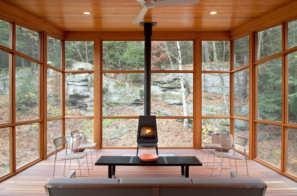 Buckeye Heating and Cooling for a Rustic Sunroom with a Wood Porch and Bug Acres of Woodstock by Cwb Architects