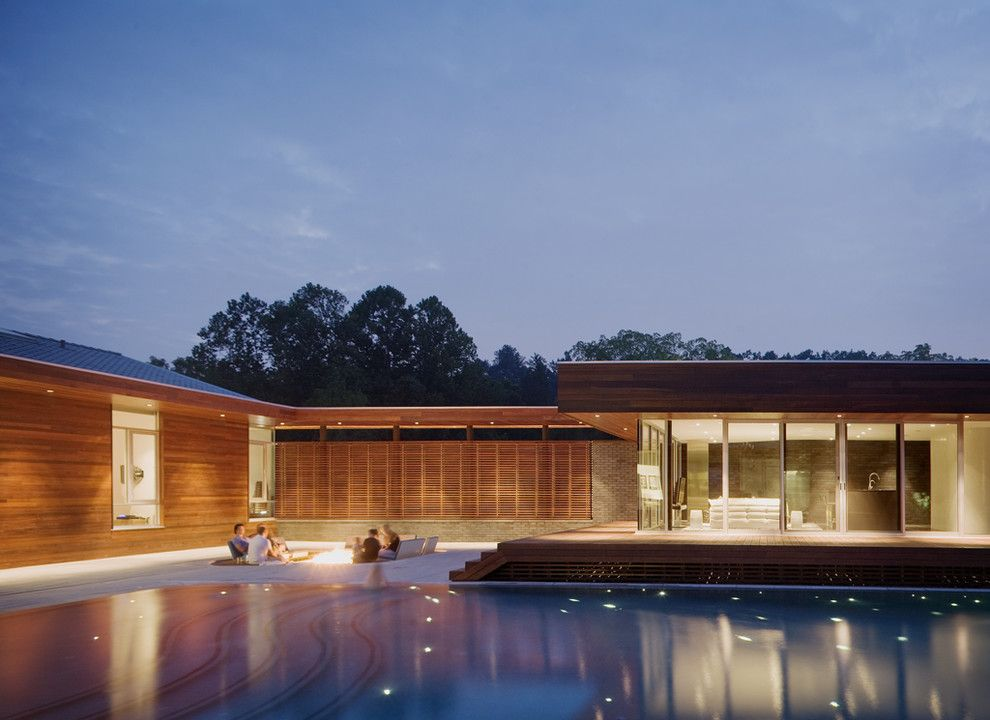 Budger for a Contemporary Pool with a Horizontal Slat Fence and Curved House by Hufft Projects