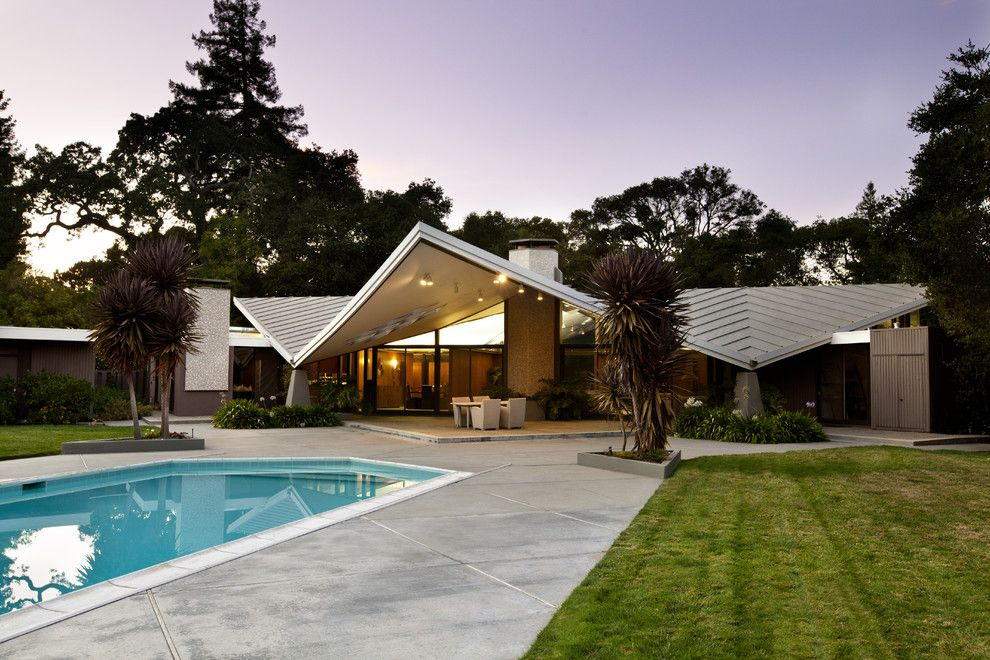 Budger for a Midcentury Exterior with a Standing Seam Roof and Portfolio by Bernard Andre Photography
