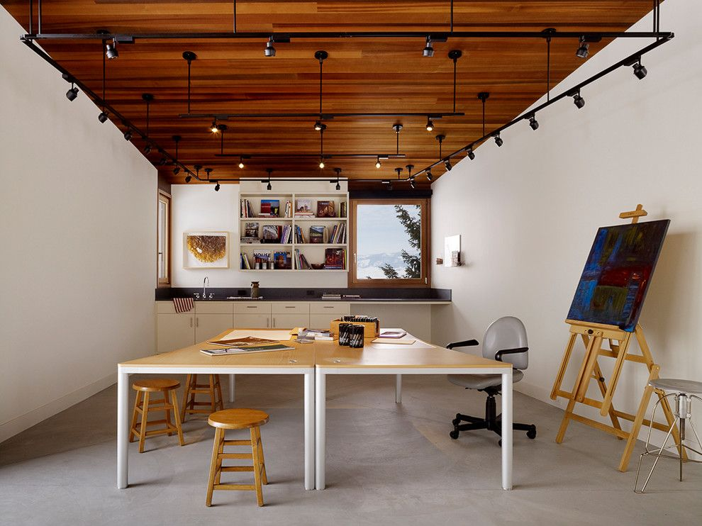 Burke Flooring for a Contemporary Home Office with a Canvas Painting and Butte Residence by Carney Logan Burke Architects