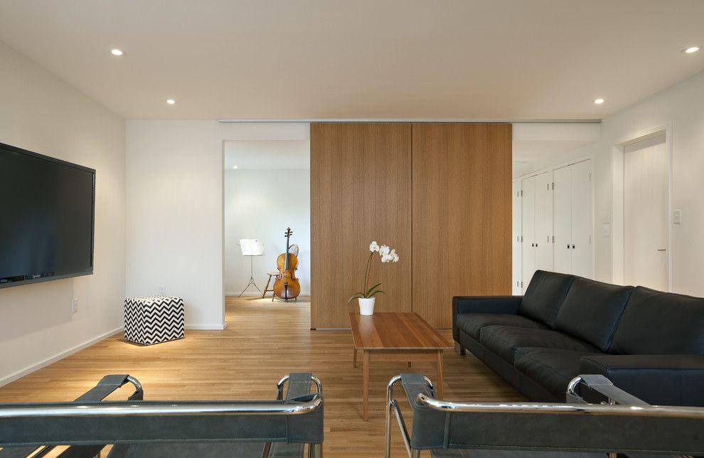 Burke Flooring for a Modern Family Room with a Black Sofa and Arlington Ridge by Reve Design Studio, Inc.