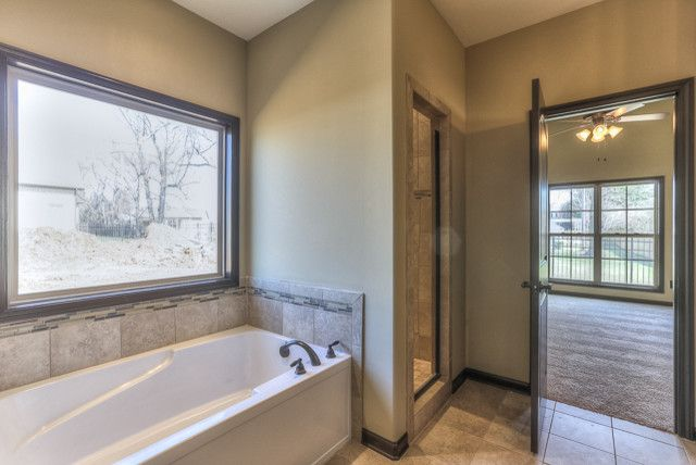 Buster Crabbe Pools for a Contemporary Bathroom with a Clarksville and All Brick Ranch Home in Gated Community by Crabbe Homes