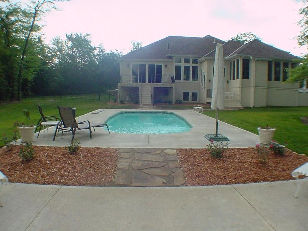 Buster Crabbe Pools for a Traditional Pool with a Back of House and Hardscape Projects by Debbie's Lawn Busters