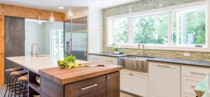 Butcher Block Nyc for a Transitional Kitchen with a Stainless Farmhouse Sink and Kitchen with Industrial Touches by Design Harmony