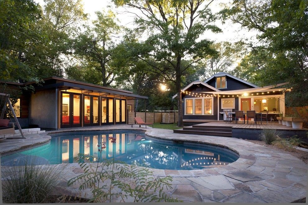 Cabot House Furniture for a Modern Pool with a Pavers and Travis Heights   Pool by Risinger Homes