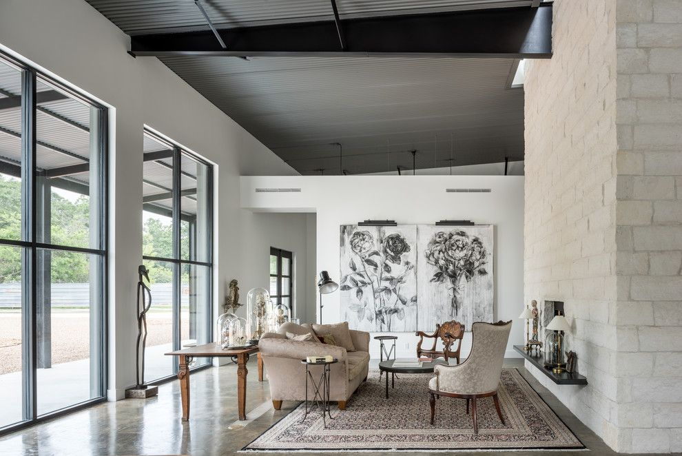 Canopy Houston for a Industrial Living Room with a Concrete Floor and Delz Warehouse by Content Architecture