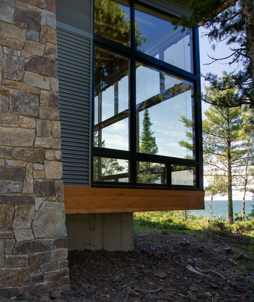 Castle Metals for a Modern Exterior with a Lakefront and Eagle Harbor Cabin by Finne Architects