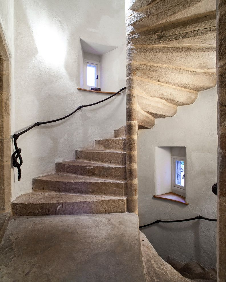 Castle Metals for a Rustic Staircase with a Castle and Dalcross Castle by Maxwell & Company Architects