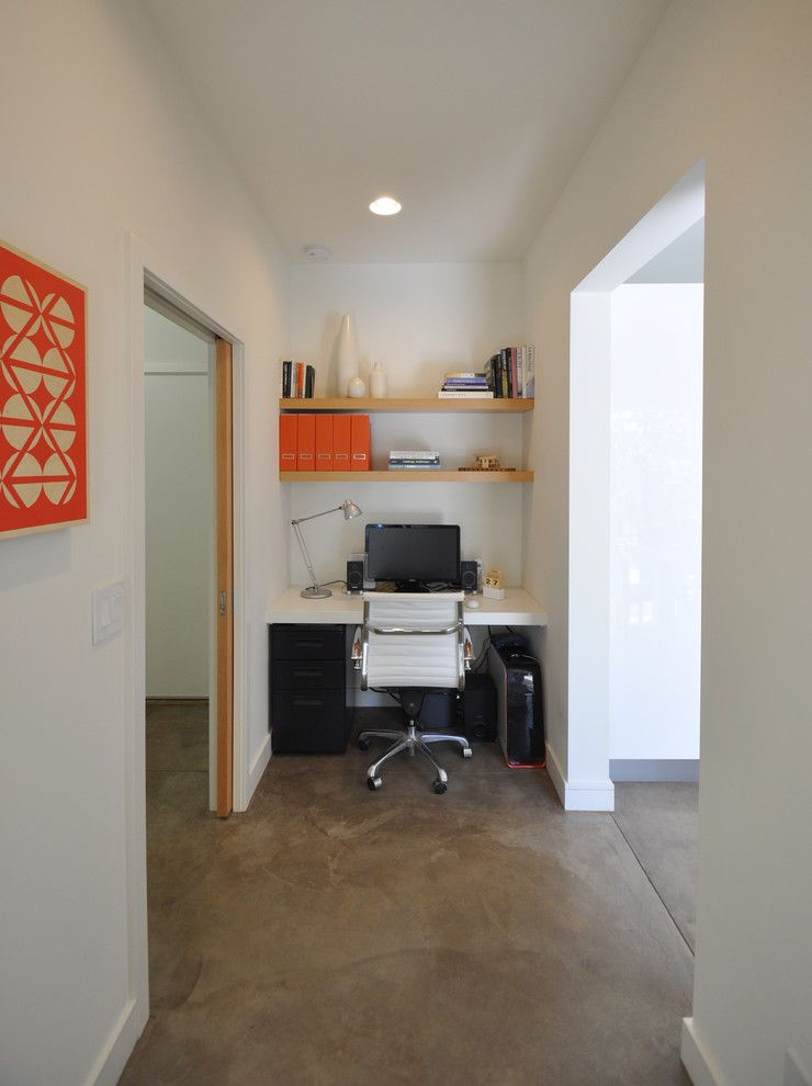 Ceco Concrete Construction for a Contemporary Home Office with a Framed Artwork and Copper Rim Trail by Steve Gates Architect + E-Terra Construction