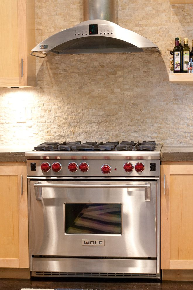 Ceco Concrete Construction for a Modern Kitchen with a Stainless Steel Range and Vanderbilt by Modern Craft Construction, Llc