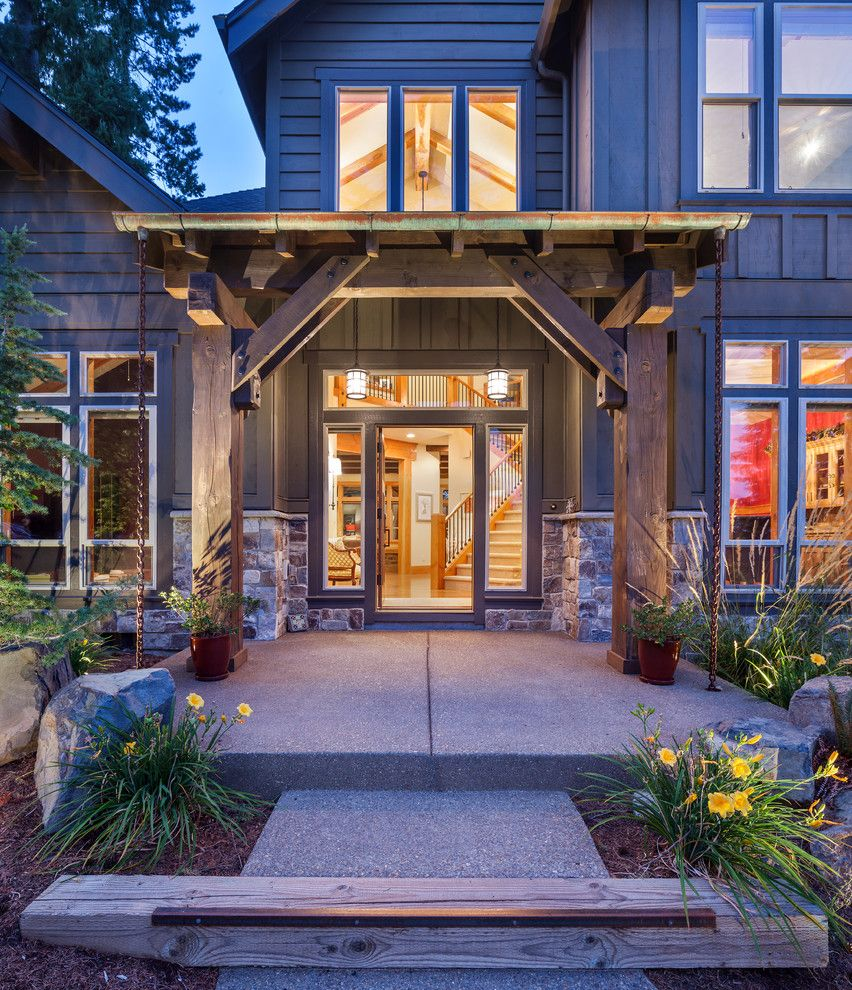 Ceco Concrete Construction for a Rustic Entry with a Lodge and Sw Portland Custom Home by Micah Day Construction Inc.