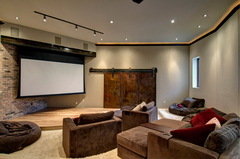 Champlin Movie Theater for a Contemporary Home Theater with a Brown Armchairs and Cliff Line Road     Golden Co by Jon Eady Photographer