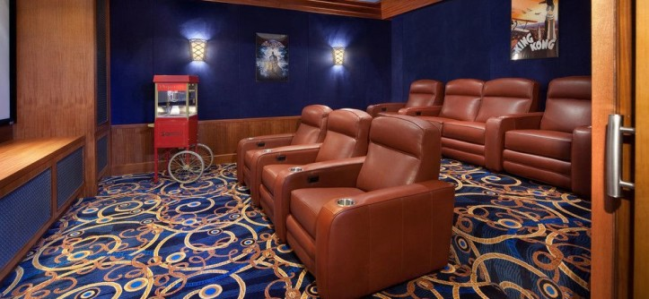 Champlin Movie Theater for a Traditional Home Theater with a Blue Carpet and Orlando Home Theater by Nordic Group