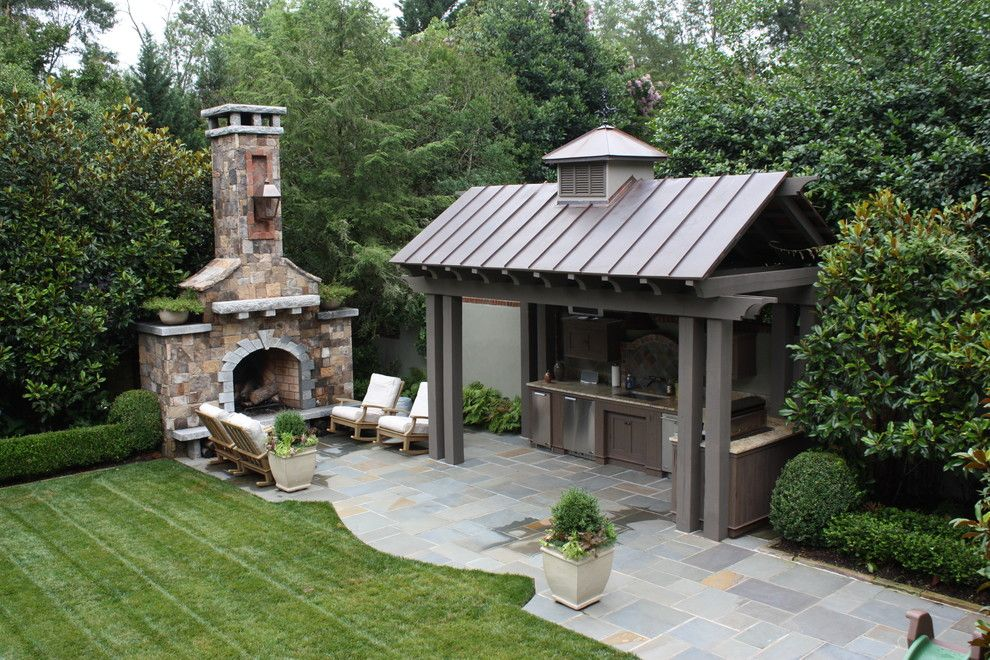Charleston Sc Points of Interest for a Traditional Patio with a Container Plants and Outdoor Kitchen and Fireplace by the Collins Group/jdp Design
