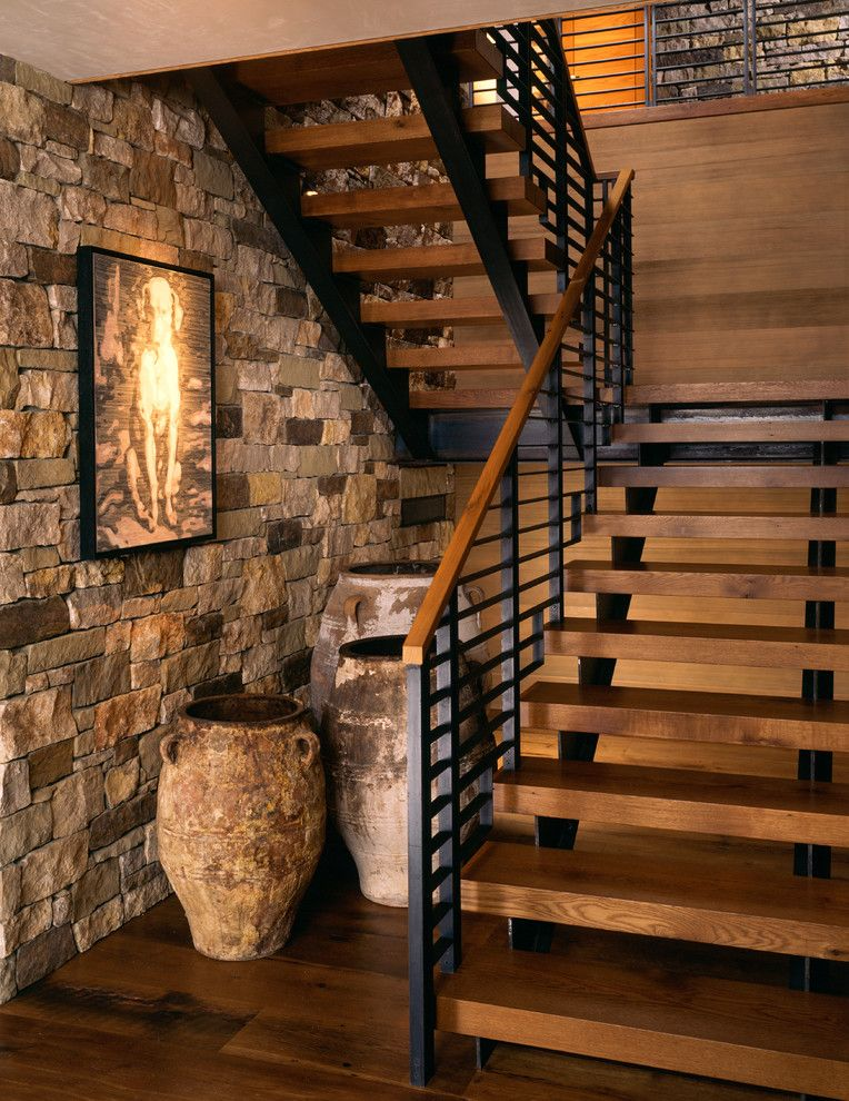 Chesapeake Landing for a Rustic Staircase with a Wood Bannister and Wilson Mountain Residence by Poss Architecture + Planning and Interior Design