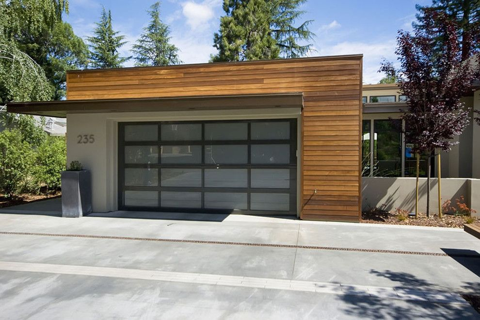 Chi Overhead Doors for a Contemporary Garage with a Garage Door and Home Front Yards by Mark Pinkerton    Vi360 Photography
