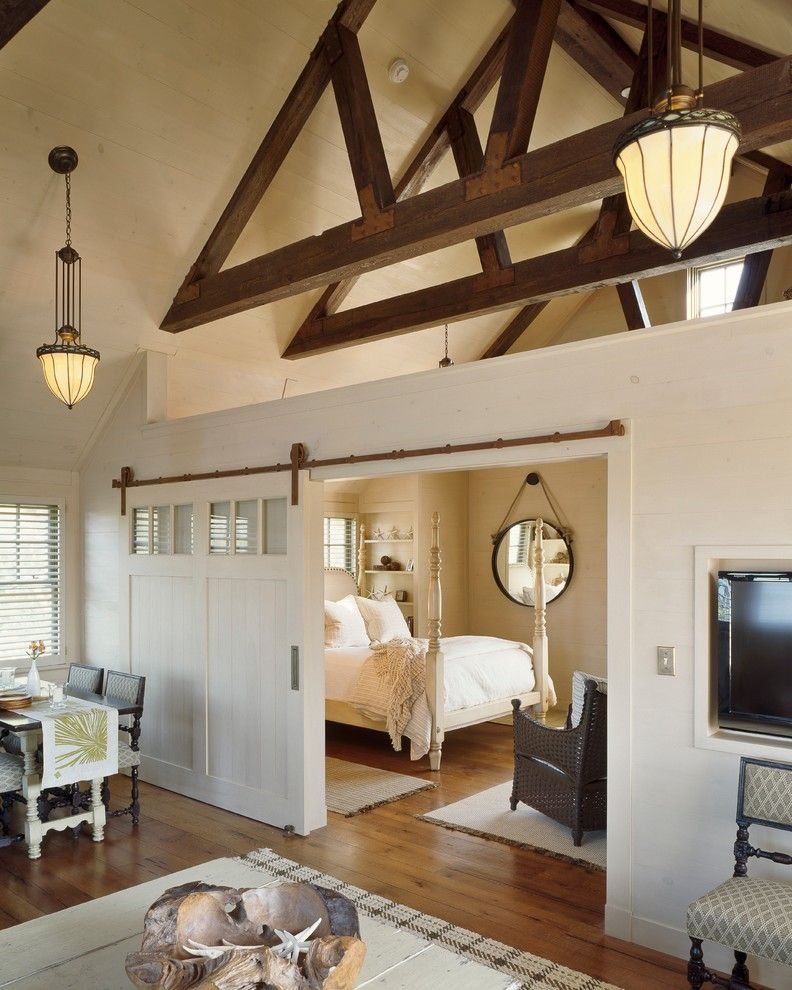 Chi Overhead Doors for a Farmhouse Bedroom with a Barn Door and West Falmouth Residence by C.H. Newton Builders, Inc