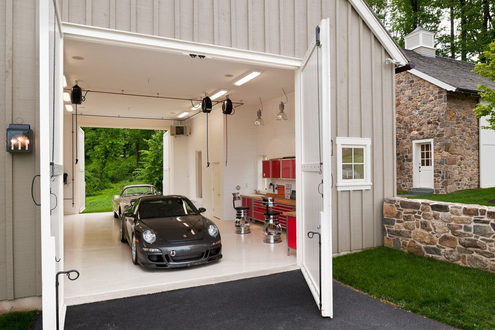 Chi Overhead Doors for a Farmhouse Garage with a Drive Thru Garage and Horseshoe by Griffiths Construction, Inc.
