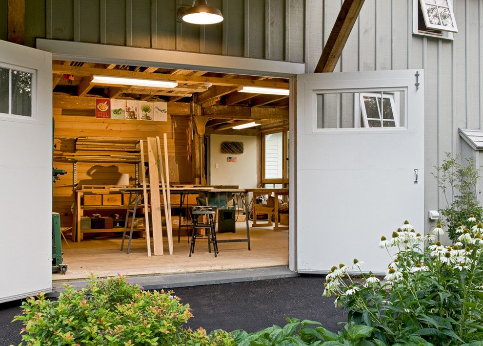 Chi Overhead Doors for a Farmhouse Shed with a Workshop and Workshop Doors by Whitten Architects