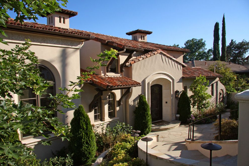 Chiminey for a Mediterranean Exterior with a Iron and Landmark Builders - Custom Home Builder by Landmark Builders