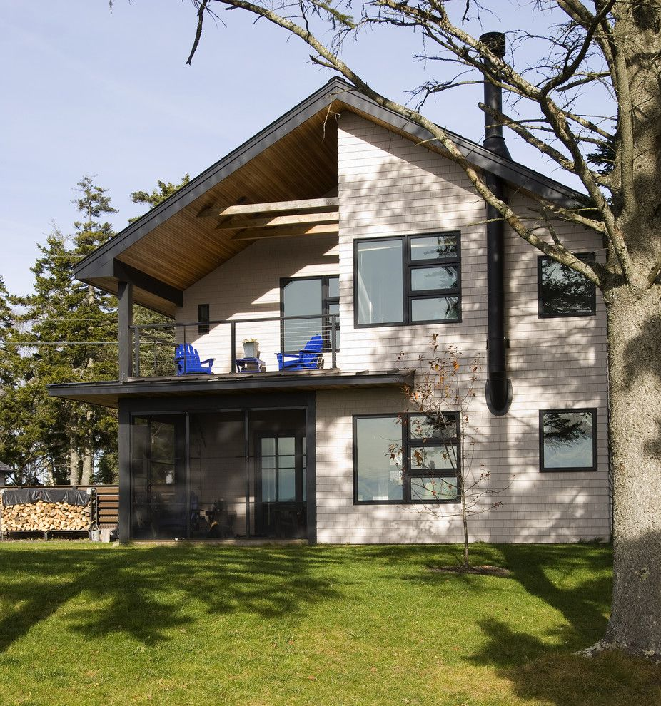 Chiminey for a Rustic Exterior with a Lawn and Exterior by Larson Shores Architects