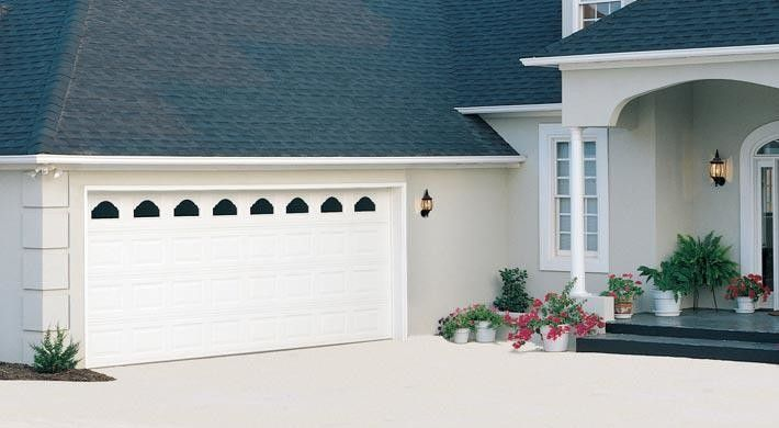Chinese Fringe Flower for a Traditional Garage with a Exterior and Raised Panel by Empire Overhead Doors, Llc