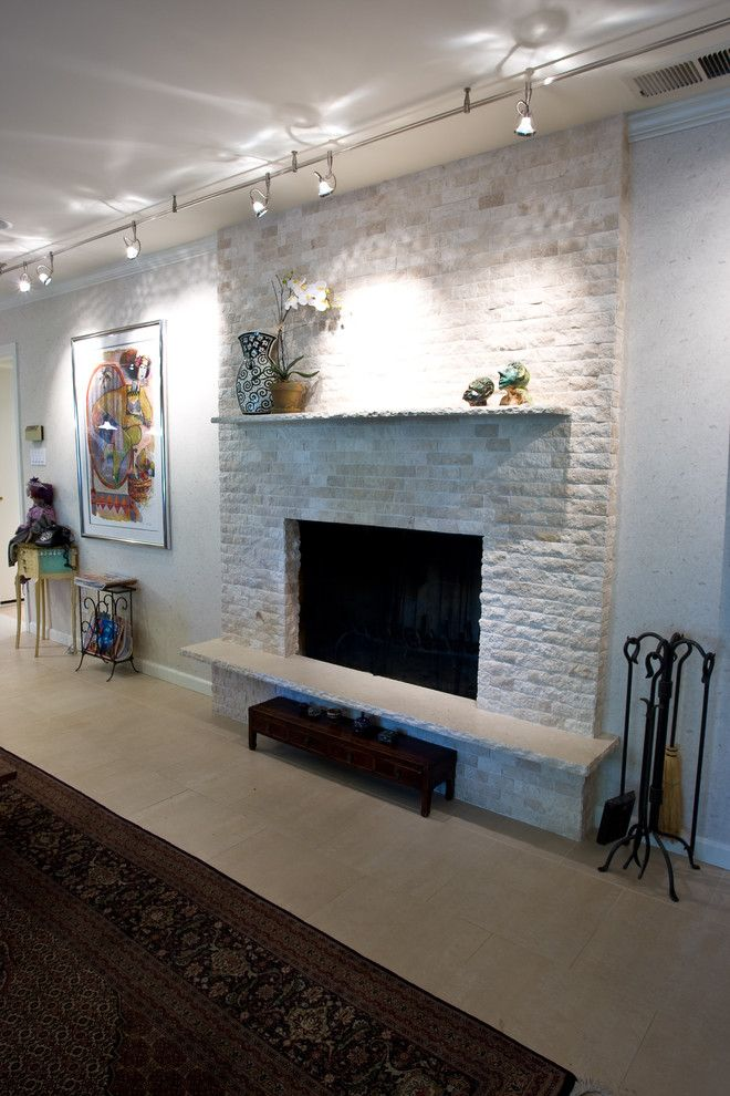 Chiseled Face for a Traditional Family Room with a Chiseled Edge Slab Mantle and Tile Fireplace Surround by Gr8work Builders Inc.