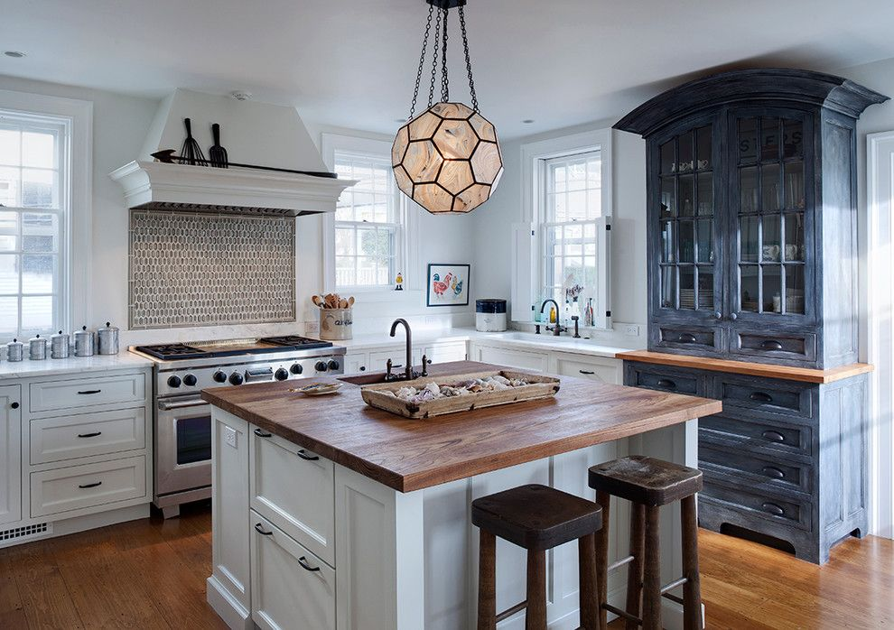 Cinder Block Dimensions for a Transitional Kitchen with a Blue Hutch and Nantucket Orange Street by Buckingham Interiors + Design Llc