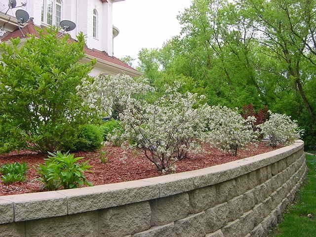 Cinder Block Retaining Wall for a Modern Landscape with a Water Fountain and Spring & Fall Landscaping Add Color to Your Landscaping, Gardens & Outdoors by Jagannath & Manjula Juluri, Landscape Architects