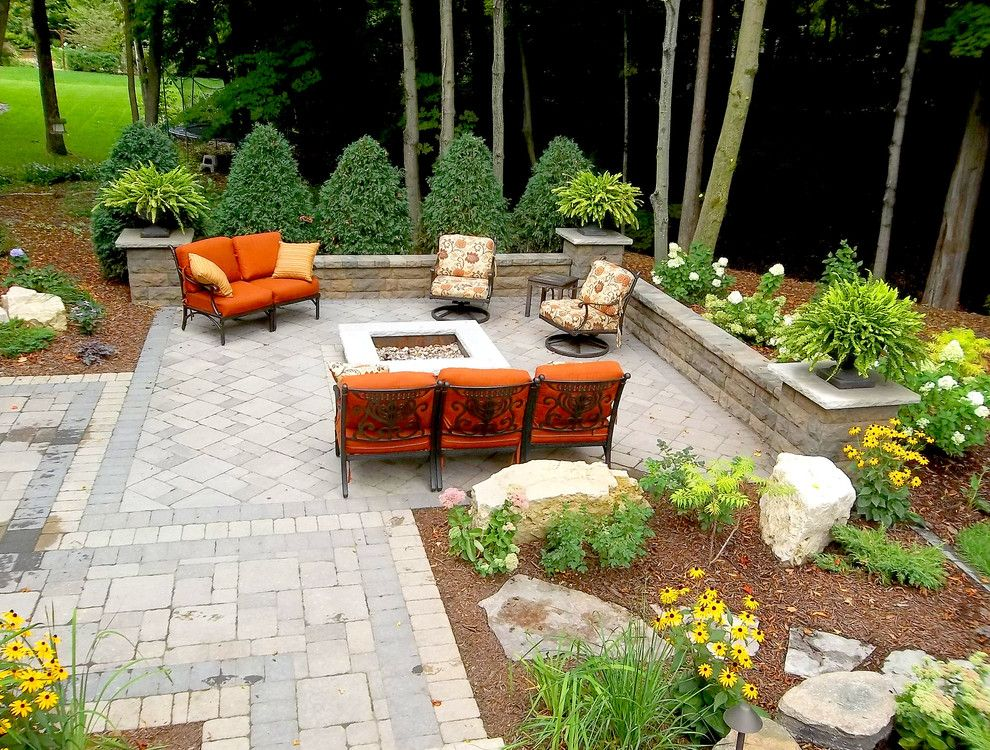 Cinder Block Retaining Wall for a Traditional Patio with a Mulch and Traditional Patio by Houzz.com