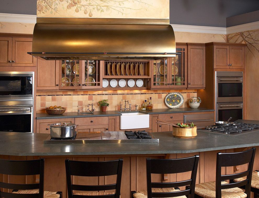 Clarks Appliances for a Traditional Kitchen with a Wolf Griddle and Copper Island Hood by Clarke Appliance Showrooms