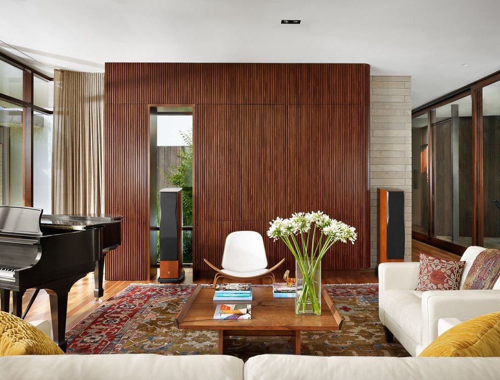 Classical Kusc for a Midcentury Family Room with a Chair and Lake View Residence by Alterstudio