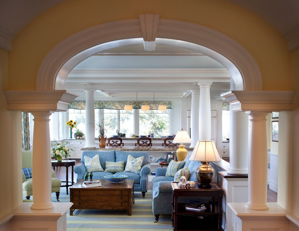 Classical Kusc for a Traditional Living Room with a Large Crown Molding and Oceanfront Estate by Windover Construction
