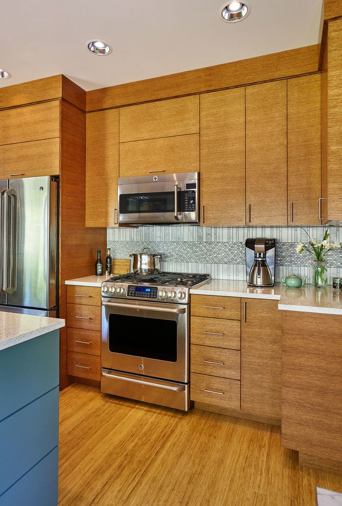 Clayton Appliance for a Contemporary Kitchen with a Rift Cut Oak Cabinets and 1990's Home Update by Charmaine Manley Design