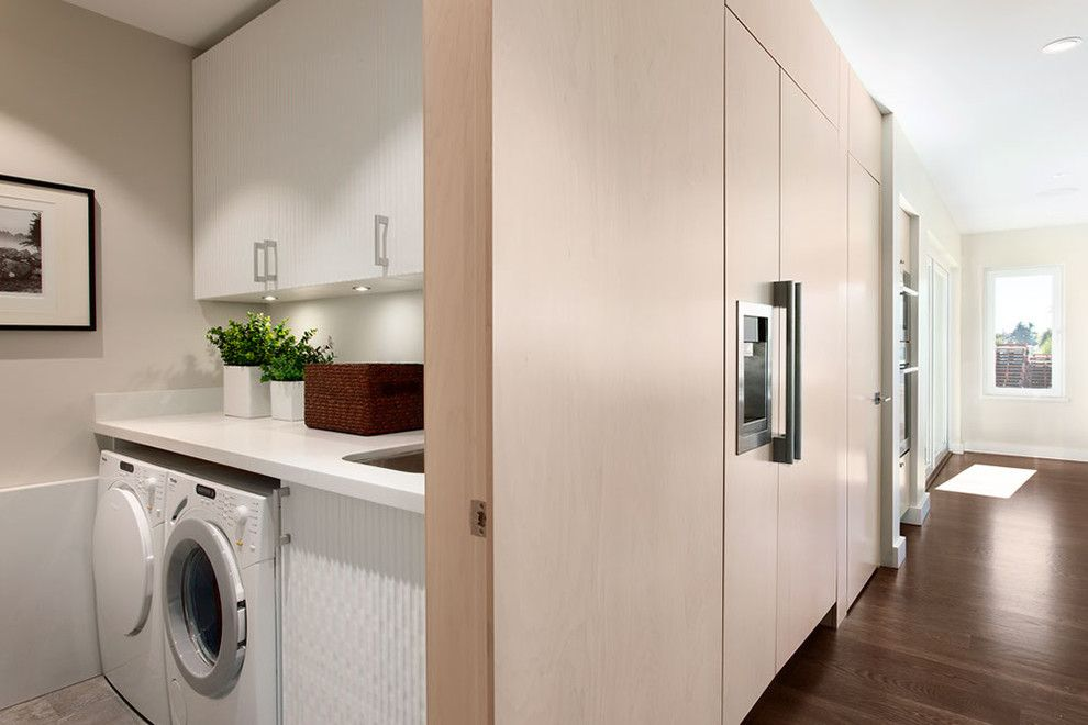Cleaning Front Load Washer for a Contemporary Laundry Room with a Closet Laundry Room and Portfolio by Sensitive Design Inc.