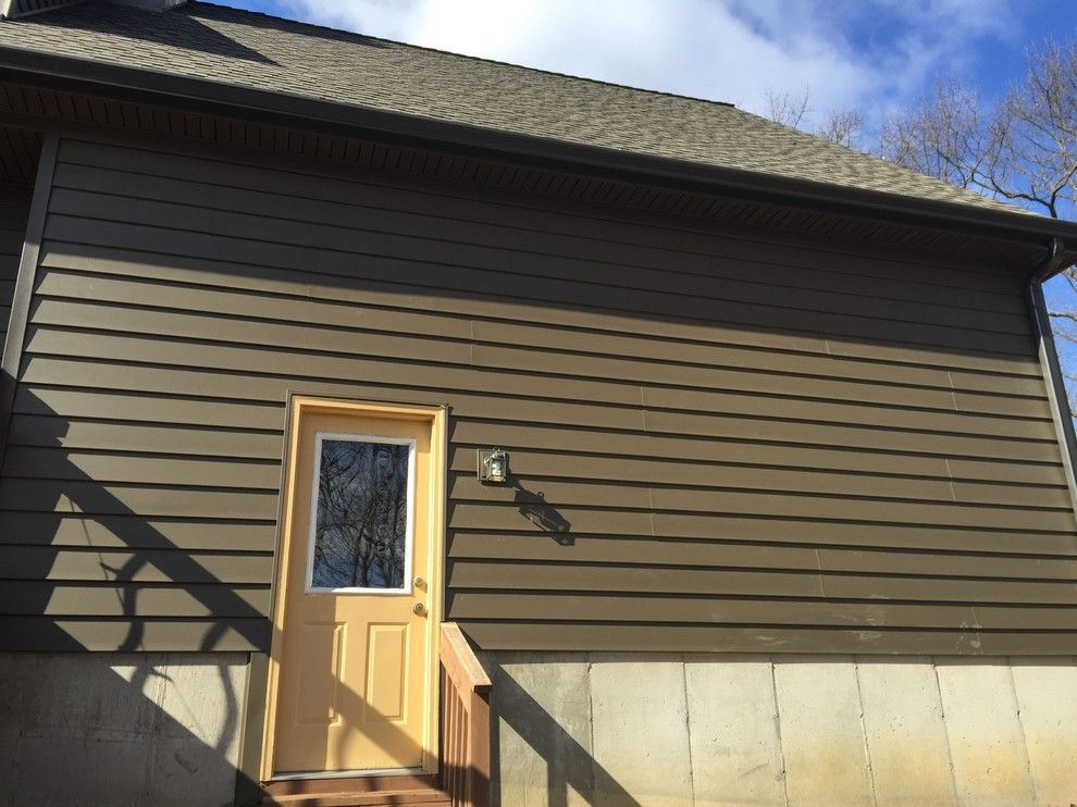 Clearview Windows for a Rustic Exterior with a Siding Stone Veneer and Insulated Wide Lap Vinyl Siding System   Chesterfield, Mo by Clearview Windows and Siding