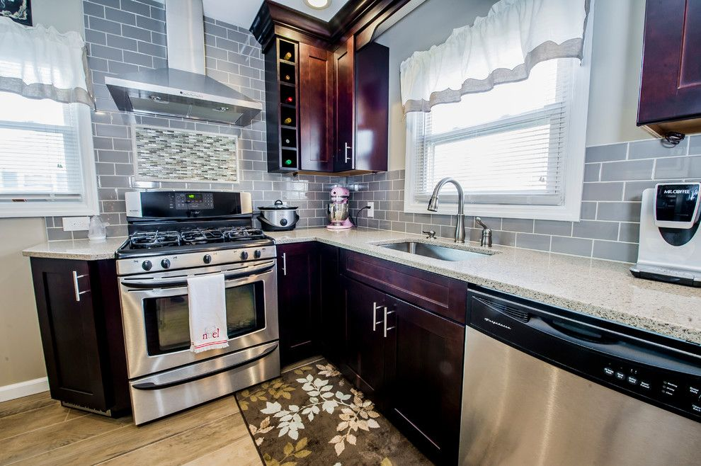 Coastal Kitchen Seattle for a  Spaces with a Kitchen Counter and Kitchen Remodeling by Razzano Homes and Remodelers, Inc.