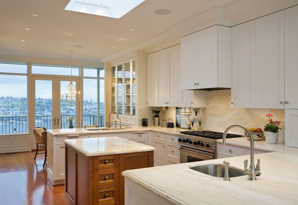 Coastal Kitchen Seattle for a Traditional Kitchen with a Wood Island and Newton Pl. by Hughes Studio Architects