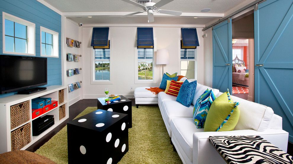 Coastal Virginia Magazine for a Beach Style Family Room with a Coastal and Bonus Room by Masterpiece Design Group