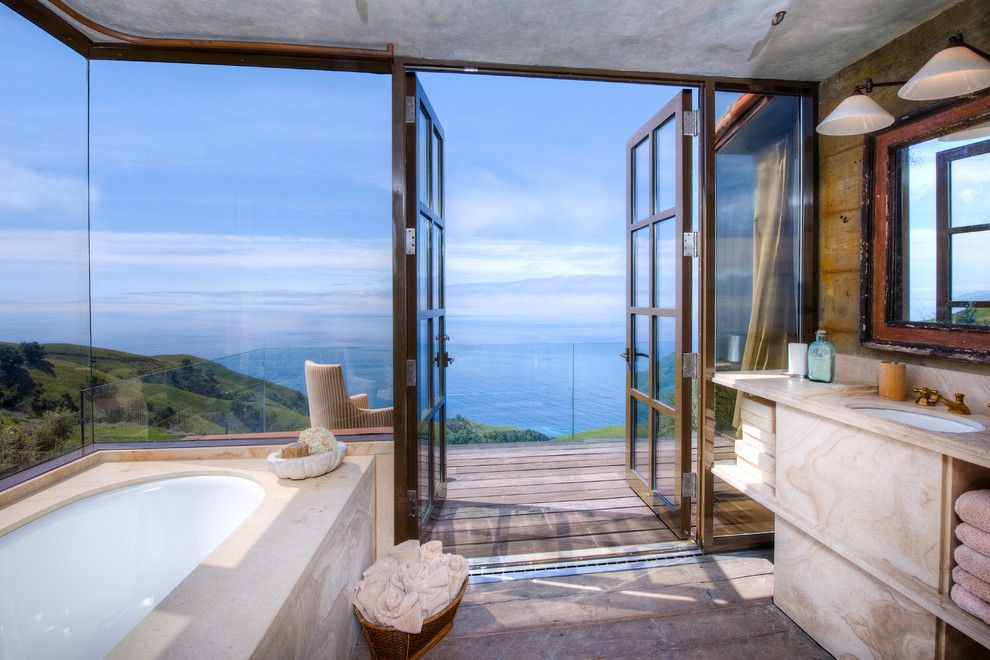 Coastline Realty for a Mediterranean Bathroom with a Rustic Wood Floor and Big Sur Coast Ridge Estate by Decker Bullock Sotheby's International Realty