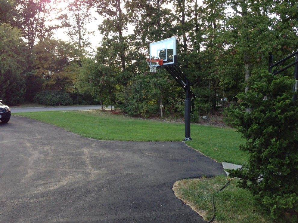College Basketball Court Dimensions for a Traditional Landscape with a in Ground Basketball System and Paul G's Pro Dunk Gold Basketball System on a 20x30 in Lorton, Va by Pro Dunk Hoops