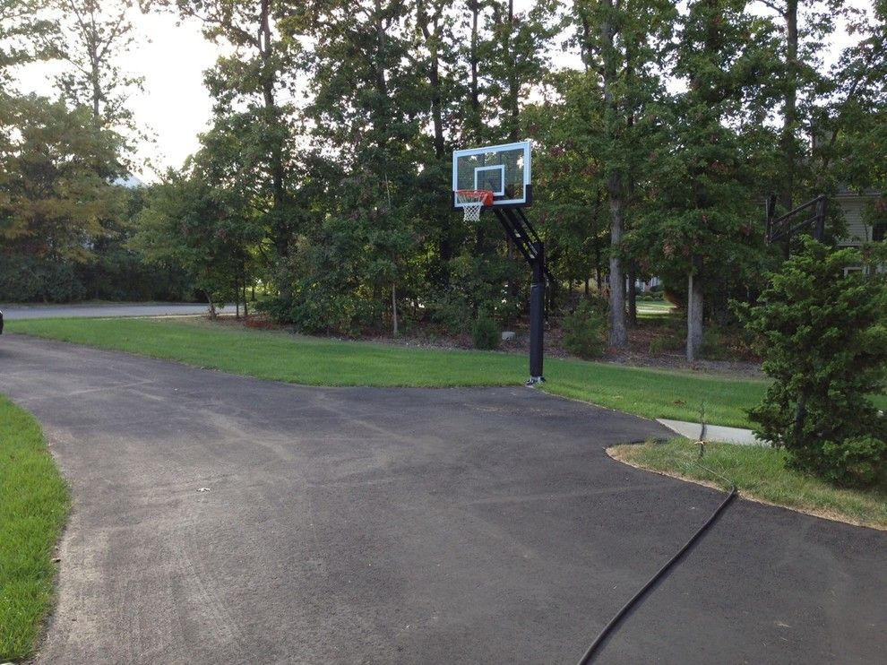 College Basketball Court Dimensions for a Traditional Landscape with a Pro Dunk Gold Basketball System and Paul G's Pro Dunk Gold Basketball System on a 20x30 in Lorton, Va by Pro Dunk Hoops