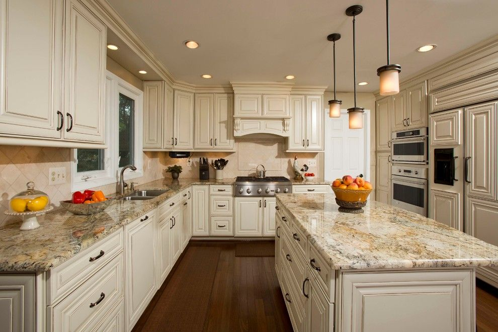 Colonial Marble and Granite for a Traditional Kitchen with a Dark Hardwood and a Kitchen Designed for Family Gathering by Michael Nash Design, Build & Homes
