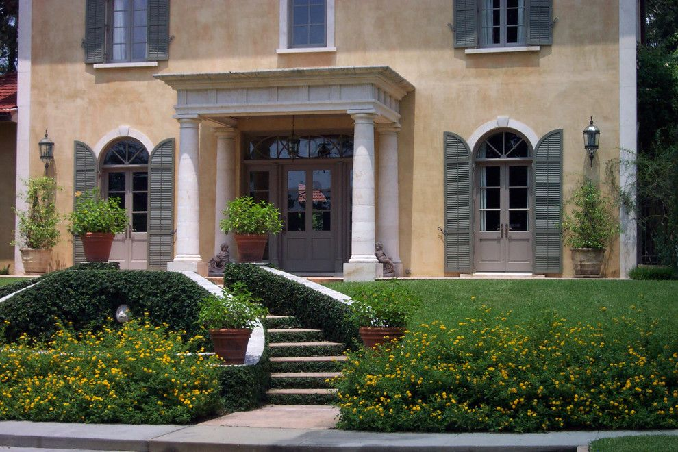 Colonnade Atlanta for a Mediterranean Exterior with a Macedonia Limestone Columned Entry with Entablature and Front View of Tuscan Style Villa by Bella Dura Architectural Stone