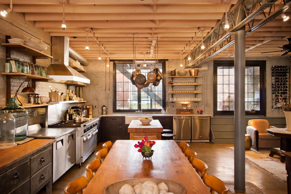 Concrete Masonry Unit for a Industrial Kitchen with a Rectangular Dining Table and Kitchen & Dining Room by Bennett Frank McCarthy Architects, Inc.